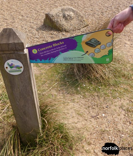 Dunwich Heath and Beach - signpost about concrete block on the beach