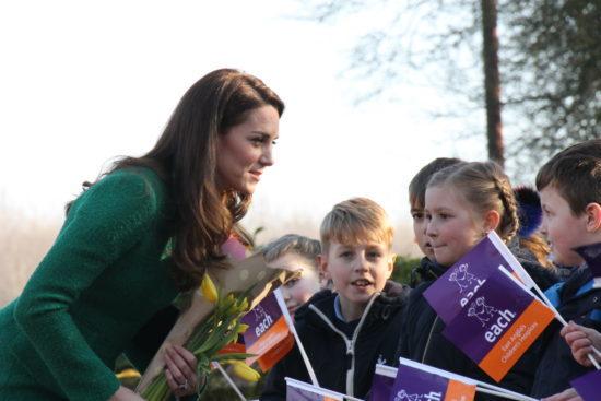 Duchess of Cambridge meeting children during visit to old hospice in Quidenham, Norfolk
