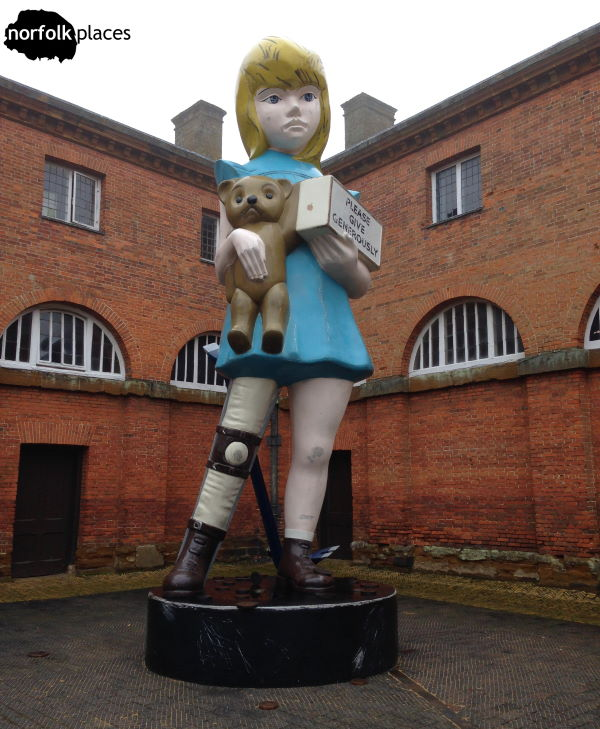 Damien Hirst's Charity statue at Houghton Hall
